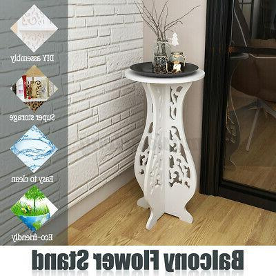 white modern small round side table beside